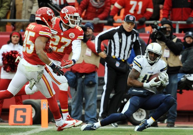 Nov 24, 2013; Kansas City, MO, USA; San Diego Chargers wide receiver Seyi Ajirotutu (16) makes a catch for a touchdown as Kansas City Chiefs cornerback Sean Smith (27) is late on the coverage during the fourth quarter of the game at Arrowhead Stadium. The Chargers won 41-38. Mandatory Credit: Denny Medley-USA TODAY Sports