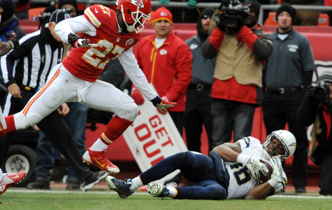 Nov 24, 2013; Kansas City, MO, USA; San Diego Chargers wide receiver Seyi Ajirotutu (16) makes a catch for a touchdown as Kansas City Chiefs cornerback Sean Smith (27) is late on the coverage during the second half of the game at Arrowhead Stadium. The Chargers won 41-38. Mandatory Credit: Denny Medley-USA TODAY Sports