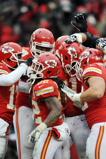 Nov 24, 2013; Kansas City, MO, USA; Kansas City Chiefs wide receiver Dwayne Bowe (82) is congratulated by teammates after scoring during the second half of the game against the San Diego Chargers at Arrowhead Stadium. The Chargers won 41-38. Mandatory Credit: Denny Medley-USA TODAY Sports