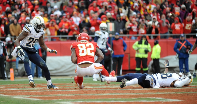 Nov 24, 2013; Kansas City, MO, USA; Kansas City Chiefs wide receiver Dwayne Bowe (82) scores a touchdown against the San Diego Chargers during the second half of the game at Arrowhead Stadium. The Chargers won 41-38. Mandatory Credit: Denny Medley-USA TODAY Sports