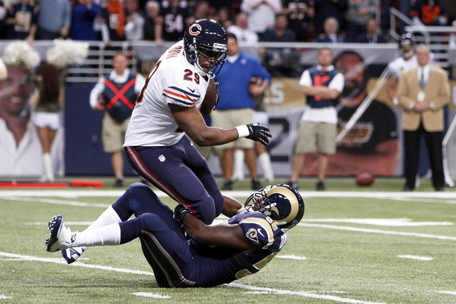 Nov 24, 2013; St. Louis, MO, USA; Chicago Bears running back Michael Bush (29) is brought down by St. Louis Rams outside linebacker Jo-Lonn Dunbar (58) in the third quarter at the Edward Jones Dome. Mandatory Credit: Scott Kane-USA TODAY Sports