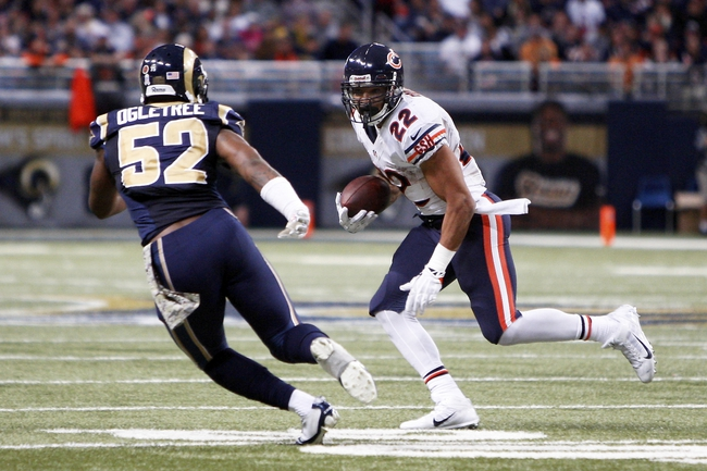 Nov 24, 2013; St. Louis, MO, USA; Chicago Bears running back Matt Forte (22) looks to get past St. Louis Rams outside linebacker Alec Ogletree (52) during the third quarter at the Edward Jones Dome. Mandatory Credit: Scott Kane-USA TODAY Sports