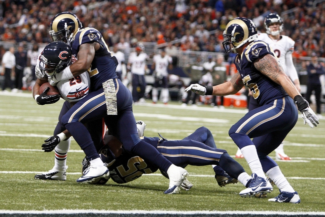Nov 24, 2013; St. Louis, MO, USA; Chicago Bears running back Michael Bush (29) is tackled by St. Louis Rams outside linebacker Alec Ogletree (52) during the fourth quarter at the Edward Jones Dome. Mandatory Credit: Scott Kane-USA TODAY Sports
