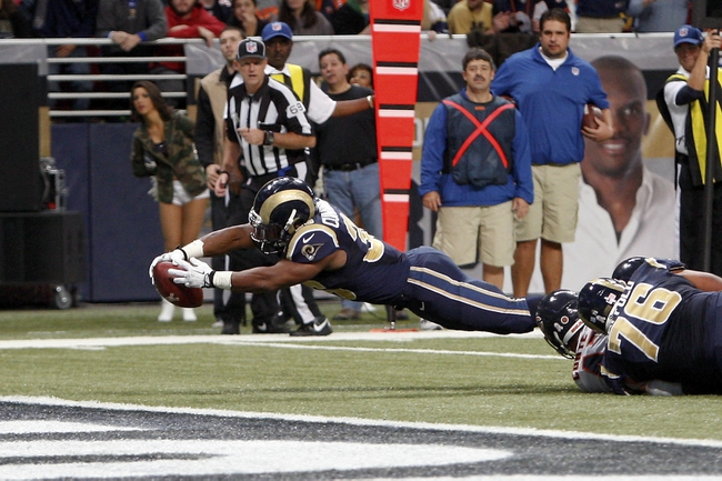 Nov 24, 2013; St. Louis, MO, USA; St. Louis Rams running back Benny Cunningham (36) leaps to score a touchdown against the Chicago Bears at the Edward Jones Dome. Mandatory Credit: Scott Kane-USA TODAY Sports