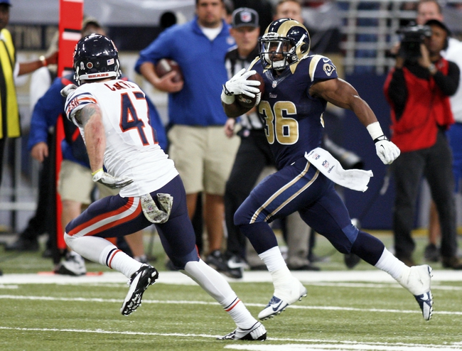 Nov 24, 2013; St. Louis, MO, USA; Chicago Bears free safety Chris Conte (47) closes in on St. Louis Rams running back Benny Cunningham (36) as he carries the ball at the Edward Jones Dome. Mandatory Credit: Scott Kane-USA TODAY Sports