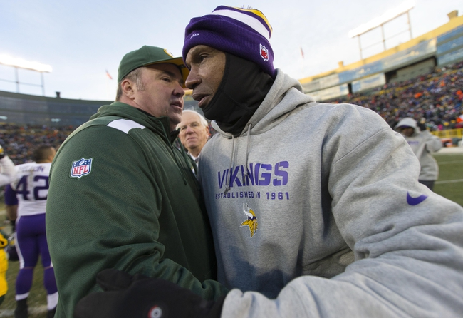 Nov 24, 2013; Green Bay, WI, USA; Green Bay Packers head coach Mike McCarthy (left) greets Minnesota Vikings head coach Leslie Frazier (right) following the game at Lambeau Field.  The Vikings and Packers tied 26-26.  Mandatory Credit: Jeff Hanisch-USA TODAY Sports