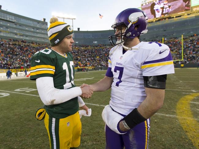 Nov 24, 2013; Green Bay, WI, USA; Green Bay Packers quarterback Matt Flynn (10) greets Minnesota Vikings quarterback Christian Ponder (7) following the game at Lambeau Field.  The Vikings and Packers tied 26-26.  Mandatory Credit: Jeff Hanisch-USA TODAY Sports