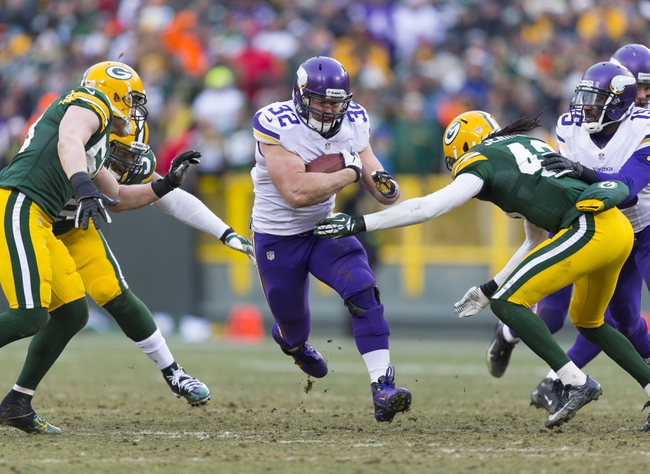 Nov 24, 2013; Green Bay, WI, USA; Minnesota Vikings running back Toby Gerhart (32) rushes with the football during overtime against the Green Bay Packers at Lambeau Field.  The Vikings and Packers tied 26-26.  Mandatory Credit: Jeff Hanisch-USA TODAY Sports