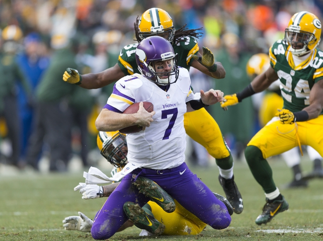Nov 24, 2013; Green Bay, WI, USA; Minnesota Vikings quarterback Christian Ponder (7) is sacked by Green Bay Packers defensive end Mike Neal (96) during the fourth quarter at Lambeau Field.  The Vikings and Packers tied 26-26.  Mandatory Credit: Jeff Hanisch-USA TODAY Sports