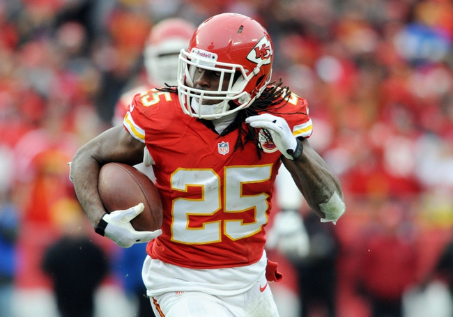 Nov 24, 2013; Kansas City, MO, USA; Kansas City Chiefs running back Jamaal Charles (25) runs for yardage during the second half of the game against the San Diego Chargers at Arrowhead Stadium. The Chargers won 41-38. Mandatory Credit: Denny Medley-USA TODAY Sports