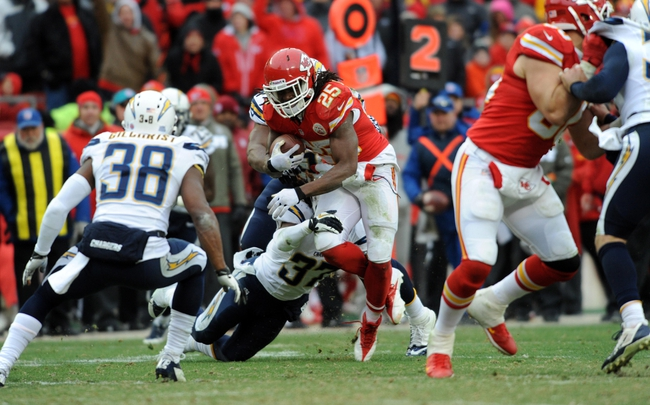 Nov 24, 2013; Kansas City, MO, USA; Kansas City Chiefs running back Jamaal Charles (25) runs the ball as San Diego Chargers defensive back Jahleel Addae (37) makes the tackle during the second half of the game at Arrowhead Stadium. The Chargers won 41-38. Mandatory Credit: Denny Medley-USA TODAY Sports