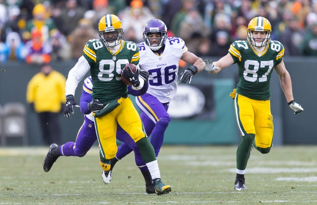 Nov 24, 2013; Green Bay, WI, USA; Green Bay Packers wide receiver James Jones (89) rushes with the football after catching a pass during overtime against the Minnesota Vikings at Lambeau Field.  The Vikings and Packers tied 26-26.  Mandatory Credit: Jeff Hanisch-USA TODAY Sports