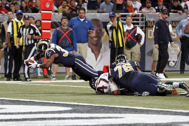 Nov 24, 2013; St. Louis, MO, USA; St. Louis Rams running back Benny Cunningham (36) dives to score a touchdown during the fourth quarter against the Chicago Bears at the Edward Jones Dome. Mandatory Credit: Scott Kane-USA TODAY Sports