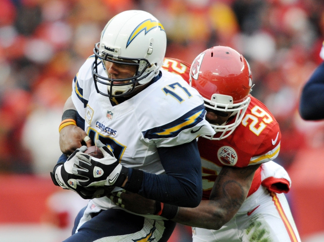Nov 24, 2013; Kansas City, MO, USA; San Diego Chargers quarterback Philip Rivers (17) is sacked by Kansas City Chiefs strong safety Eric Berry (29) during the second half of the game at Arrowhead Stadium. The Chargers won 41-38. Mandatory Credit: Denny Medley-USA TODAY Sports