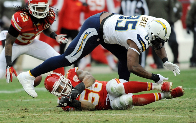 Nov 24, 2013; Kansas City, MO, USA; Kansas City Chiefs inside linebacker Derrick Johnson (56) breaks up a pass intended for San Diego Chargers tight end Antonio Gates (85) during the second half of the game at Arrowhead Stadium. The Chargers won 41-38. Mandatory Credit: Denny Medley-USA TODAY Sports