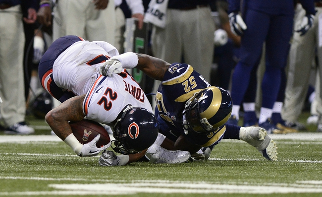 Nov 24, 2013; St. Louis, MO, USA; Chicago Bears running back Matt Forte (22) is tackled by St. Louis Rams outside linebacker Alec Ogletree (52) during the second half at the Edward Jones Dome. St. Louis defeated Chicago 42-21. Mandatory Credit: Jeff Curry-USA TODAY Sports
