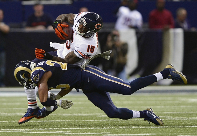 Nov 24, 2013; St. Louis, MO, USA; Chicago Bears wide receiver Brandon Marshall (15) is tackled by St. Louis Rams strong safety T.J. McDonald (25) during the second half at the Edward Jones Dome. St. Louis defeated Chicago 42-21. Mandatory Credit: Jeff Curry-USA TODAY Sports