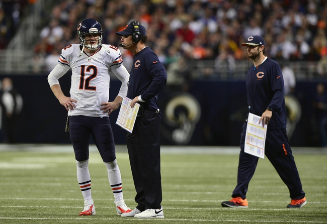 Nov 24, 2013; St. Louis, MO, USA; Chicago Bears quarterback Josh McCown (12) talks with head coach Marc Trestman during the second half against the St. Louis Rams at the Edward Jones Dome. St. Louis defeated Chicago 42-21. Mandatory Credit: Jeff Curry-USA TODAY Sports
