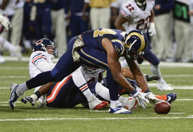 Nov 24, 2013; St. Louis, MO, USA; St. Louis Rams defensive end Robert Quinn (94) picks up a ball he stripped from Chicago Bears quarterback Josh McCown (12) and returned it for a 31 yard touchdown during the second half at the Edward Jones Dome. St. Louis defeated Chicago 42-21. Mandatory Credit: Jeff Curry-USA TODAY Sports