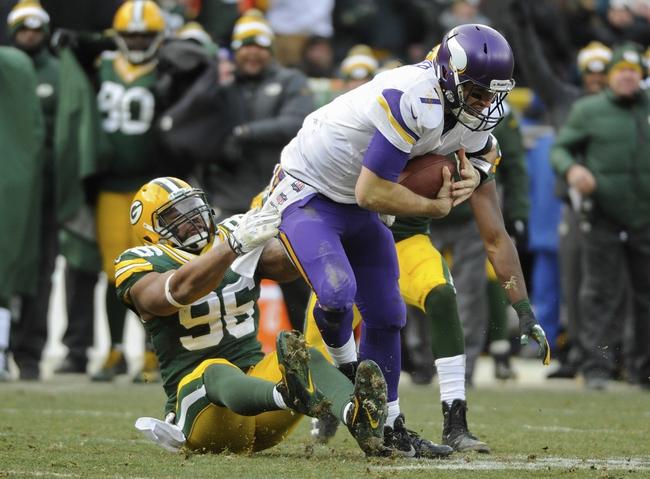 Nov 24, 2013; Green Bay, WI, USA;   Green Bay Packers defensive end Mike Neal (96) tackles Minnesota Vikings quarterback Christian Ponder (7) in the 4th quarter at Lambeau Field. Mandatory Credit: Benny Sieu-USA TODAY Sports