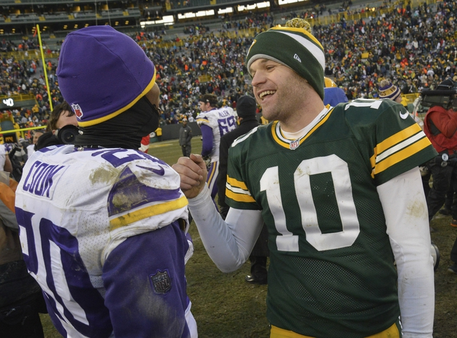 Nov 24, 2013; Green Bay, WI, USA;  Green Bay Packers quarterback Matt Flynn (10) and Minnesota Vikings cornerback Chris Cook (20) greet each other after the Packers and Vikings finished in a tie 26-26 at Lambeau Field. Mandatory Credit: Benny Sieu-USA TODAY Sports