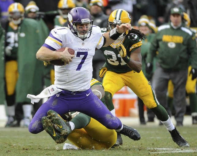 Nov 24, 2013; Green Bay, WI, USA; Minnesota Vikings quarterback Christian Ponder (7) is sacked by Green Bay Packers defensive end Mike Neal (96) in the 4th quarter at Lambeau Field. Mandatory Credit: Benny Sieu-USA TODAY Sports
