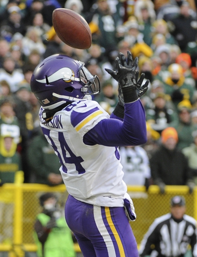 Nov 24, 2013; Green Bay, WI, USA;   Minnesota Vikings wide receiver Cordarrelle Patterson (84) can't hold onto a pass in the endzone in overtime during the game against the Green Bay Packers at Lambeau Field.  The Packers and Vikings finished in a tie 26-26.  Mandatory Credit: Benny Sieu-USA TODAY Sports