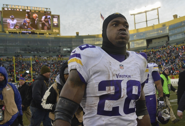 Nov 24, 2013; Green Bay, WI, USA;  Minnesota Vikings running back Adrian Peterson (28) walks off the field after the Vikings and Green Bay Packers finished in a tie 26-26 at Lambeau Field. Mandatory Credit: Benny Sieu-USA TODAY Sports
