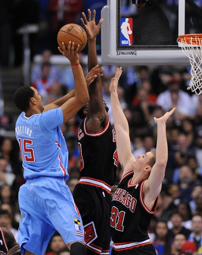 Nov 24, 2013; Los Angeles, CA, USA;  Los Angeles Clippers center Ryan Hollins (15) shoots over Chicago Bulls power forward Erik Murphy (31) and Chicago Bulls center Nazr Mohammed (48) in the second half the game at Staples Center. Clippers won 121-82. Mandatory Credit: Jayne Kamin-Oncea-USA TODAY Sports