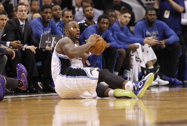 Nov 24, 2013; Orlando, FL, USA; Orlando Magic power forward Glen Davis (11) grabs the ball as he makes a steal against the Phoenix Suns during the second half at Amway Center. Phoenix Suns 104-96. Mandatory Credit: Kim Klement-USA TODAY Sports