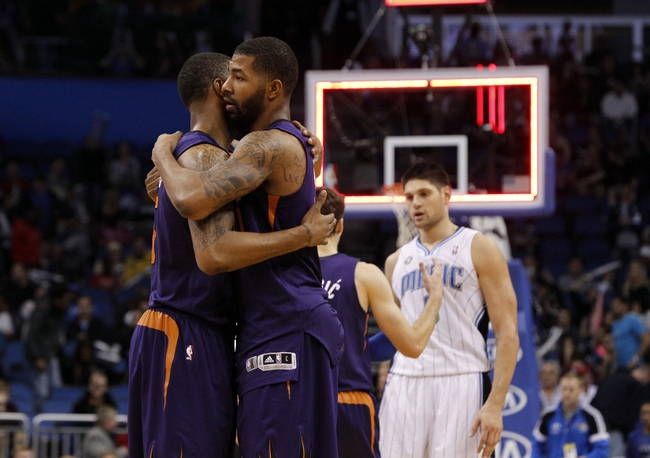 Nov 24, 2013; Orlando, FL, USA; Phoenix Suns power forward Markieff Morris (11) and power forward Marcus Morris (15) hug after they beat the Orlando Magic during the second half at Amway Center. Phoenix Suns 104-96. Mandatory Credit: Kim Klement-USA TODAY Sports