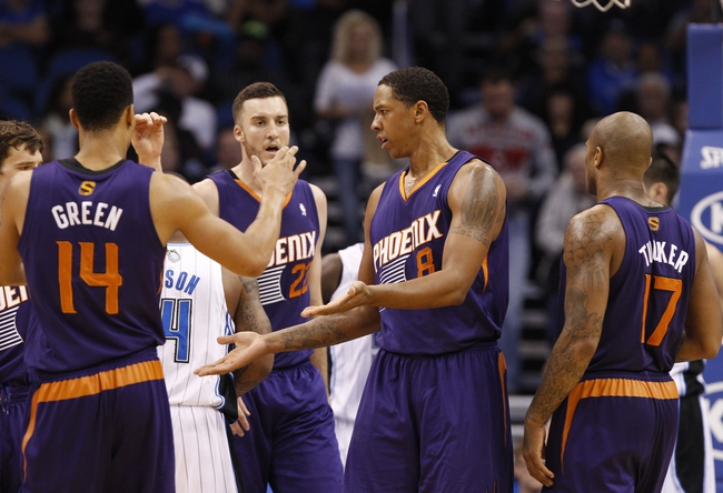 Nov 24, 2013; Orlando, FL, USA; Phoenix Suns power forward Channing Frye (8) high five teammates after he made a shot against the Orlando Magic during the second half at Amway Center. Phoenix Suns 104-96. Mandatory Credit: Kim Klement-USA TODAY Sports