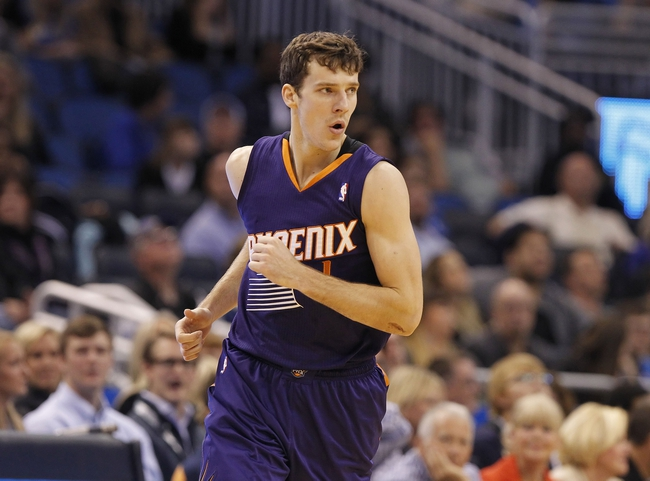 Nov 24, 2013; Orlando, FL, USA; Phoenix Suns shooting guard Goran Dragic (1) reacts and pumps his fist after he made a shot against the Orlando Magic during the second half at Amway Center. Phoenix Suns 104-96. Mandatory Credit: Kim Klement-USA TODAY Sports
