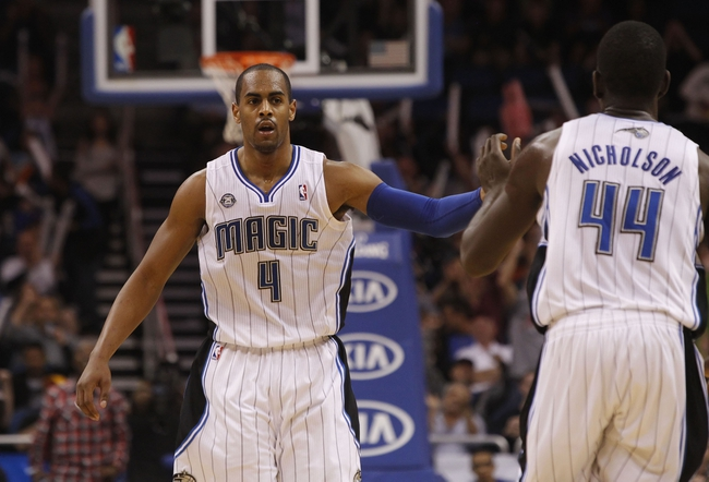 Nov 24, 2013; Orlando, FL, USA; Orlando Magic shooting guard Arron Afflalo (4) high five power forward Andrew Nicholson (44) after making a basket against the Phoenix Suns during the second half at Amway Center. Phoenix Suns 104-96. Mandatory Credit: Kim Klement-USA TODAY Sports