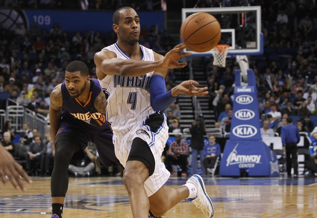 Nov 24, 2013; Orlando, FL, USA; Orlando Magic shooting guard Arron Afflalo (4) passes the ball against the Phoenix Suns during the second half at Amway Center. Phoenix Suns 104-96. Mandatory Credit: Kim Klement-USA TODAY Sports