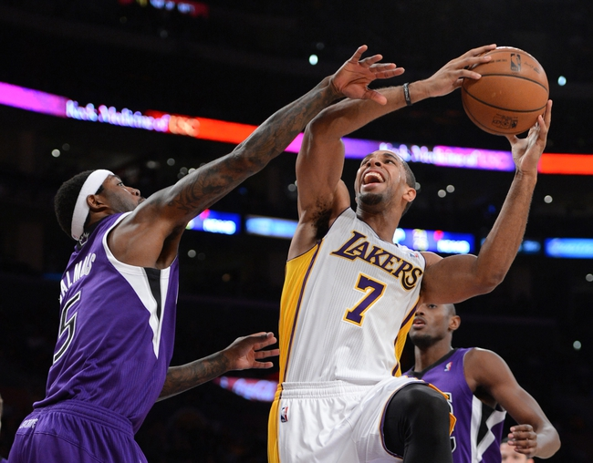 Nov 24, 2013; Los Angeles, CA, USA;   Sacramento Kings small forward John Salmons (5) fouls Los Angeles Lakers small forward Xavier Henry (7) in the first half of the game at Staples Center. Mandatory Credit: Jayne Kamin-Oncea-USA TODAY Sports