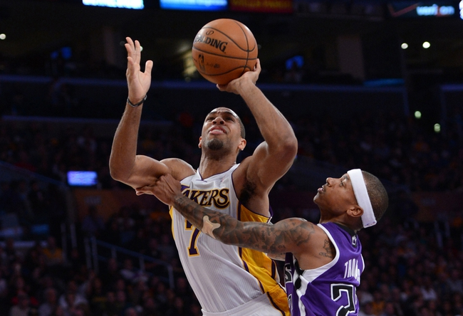 Nov 24, 2013; Los Angeles, CA, USA;   Sacramento Kings point guard Isaiah Thomas (22) fouls Los Angeles Lakers small forward Xavier Henry (7) in the first half of the game at Staples Center. Mandatory Credit: Jayne Kamin-Oncea-USA TODAY Sports