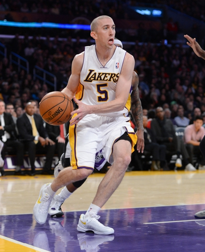 Nov 24, 2013; Los Angeles, CA, USA;   Los Angeles Lakers point guard Steve Blake (5) looks to pass in the first half of the game against the Sacramento Kings at Staples Center. Mandatory Credit: Jayne Kamin-Oncea-USA TODAY Sports