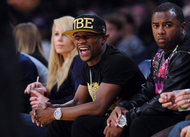 Nov 24, 2013; Los Angeles, CA, USA;  Floyd Mayweather watches the game between the Los Angeles Lakers the Sacramento Kings at Staples Center. Lakers won 100-86. Mandatory Credit: Jayne Kamin-Oncea-USA TODAY Sports