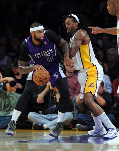Nov 24, 2013; Los Angeles, CA, USA;  Los Angeles Lakers center Jordan Hill (27) guards Sacramento Kings center DeMarcus Cousins (15) during the game at Staples Center. Lakers won 100-86. Mandatory Credit: Jayne Kamin-Oncea-USA TODAY Sports