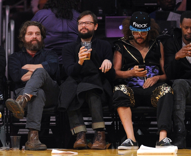 Nov 24, 2013; Los Angeles, CA, USA;  Movie actor Zach Galifianakis (left) and recording artist Redfoo (right) watch the game between the Los Angeles Lakers the Sacramento Kings at Staples Center. Lakers won 100-86. Mandatory Credit: Jayne Kamin-Oncea-USA TODAY Sports