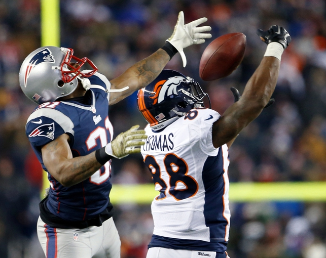 Nov 24, 2013; Foxborough, MA, USA; New England Patriots cornerback Aqib Talib (31) defends a pass intended for Denver Broncos wide receiver Demaryius Thomas (88) in the fourth quarter at Gillette Stadium. The New England Patriots defeated the Denver Broncos 34-31. Mandatory Credit: David Butler II-USA TODAY Sports