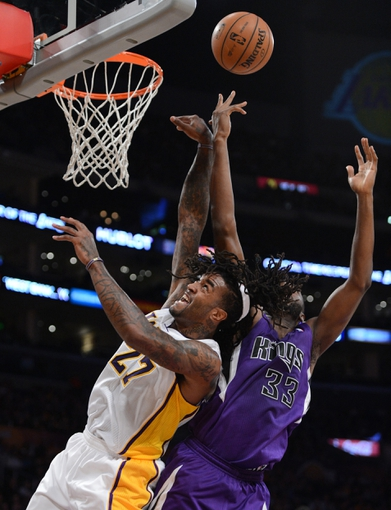 Nov 24, 2013; Los Angeles, CA, USA;   Sacramento Kings power forward Luc Richard Mbah a Moute (33) and Los Angeles Lakers center Jordan Hill (27) go for a rebound in the first half of the game at Staples Center. Mandatory Credit: Jayne Kamin-Oncea-USA TODAY Sports