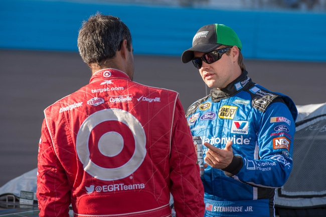 Nov 8, 2013; Avondale, AZ, USA; Sprint Cup Series driver Ricky Stenhouse Jr. (17) and driver Juan Pablo Montoya (42) during qualifying for the Advocare 500 at Phoenix International Raceway. Mandatory Credit: Jerome Miron-USA TODAY Sports
