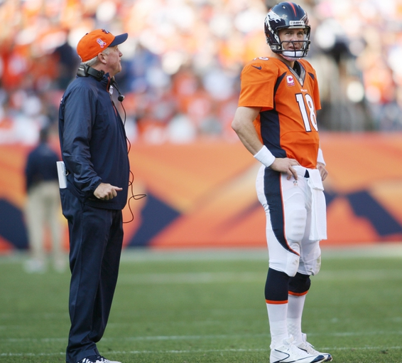 Oct 13, 2013; Denver, CO, USA; Denver Broncos quarterback Peyton Manning (18) and John Fox (left) during the game against the Jacksonville Jaguars at Sports Authority Field at Mile High. Mandatory Credit: Chris Humphreys-USA TODAY Sports