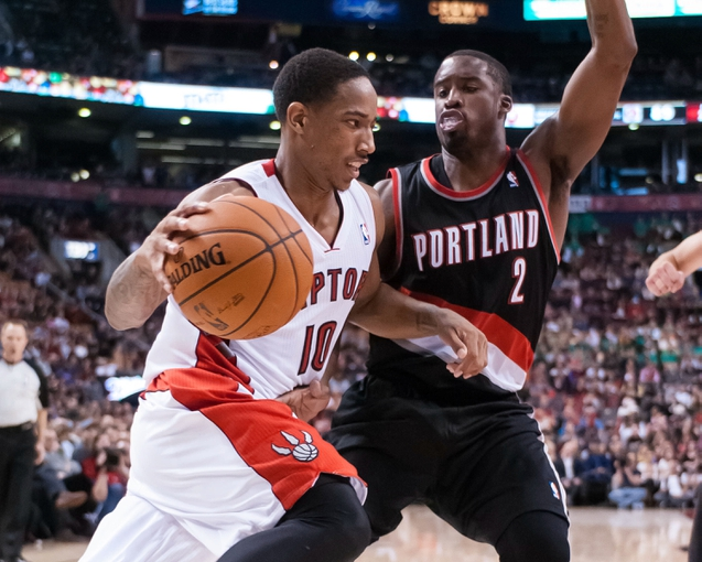 Nov 17, 2013; Toronto, Ontario, CAN;Toronto Raptors shooting guard DeMar DeRozan (10) drives the ball on the baseline with Portland Trail Blazers shooting guard Wesley Matthews (2) defending during the fourth quarter of a game at the Air Canada Centre. Portland won the game 118-110. Mandatory Credit: Mark Konezny-USA TODAY Sports