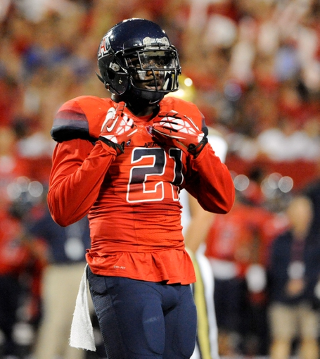 Nov 9, 2013; Tucson, AZ, USA; Arizona Wildcats safety Tra  Mayne Bondurant (21) in between plays during the second quarter against the UCLA Bruins at Arizona Stadium. Mandatory Credit: Casey Sapio-USA TODAY Sports