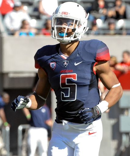 Nov 16, 2013; Tucson, AZ, USA; Arizona Wildcats receiver Trey Griffey (5) jogs onto the field in between plays during the second quarter against the Washington State Cougars at Arizona Stadium. The Cougars beat the Wildcats 24-17. Mandatory Credit: Casey Sapio-USA TODAY Sports