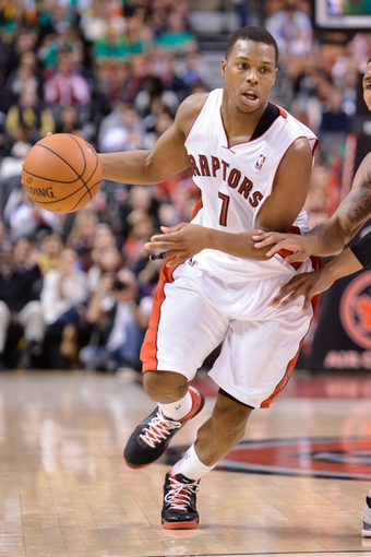 Nov 17, 2013; Toronto, Ontario, CAN; Toronto Raptors point guard Kyle Lowry (7) handles the ball at mid-court during overtime of a game against the Portland Trail Blazers at the Air Canada Centre. Portland won the game 118-110. Mandatory Credit: Mark Konezny-USA TODAY Sports