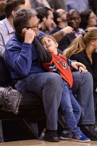 Nov 17, 2013; Toronto, Ontario, CAN; A father and son enjoy the game  between the Toronto Raptors and the Portland Trail Blazers at the Air Canada Centre. Portland won the game 118-110. Mandatory Credit: Mark Konezny-USA TODAY Sports